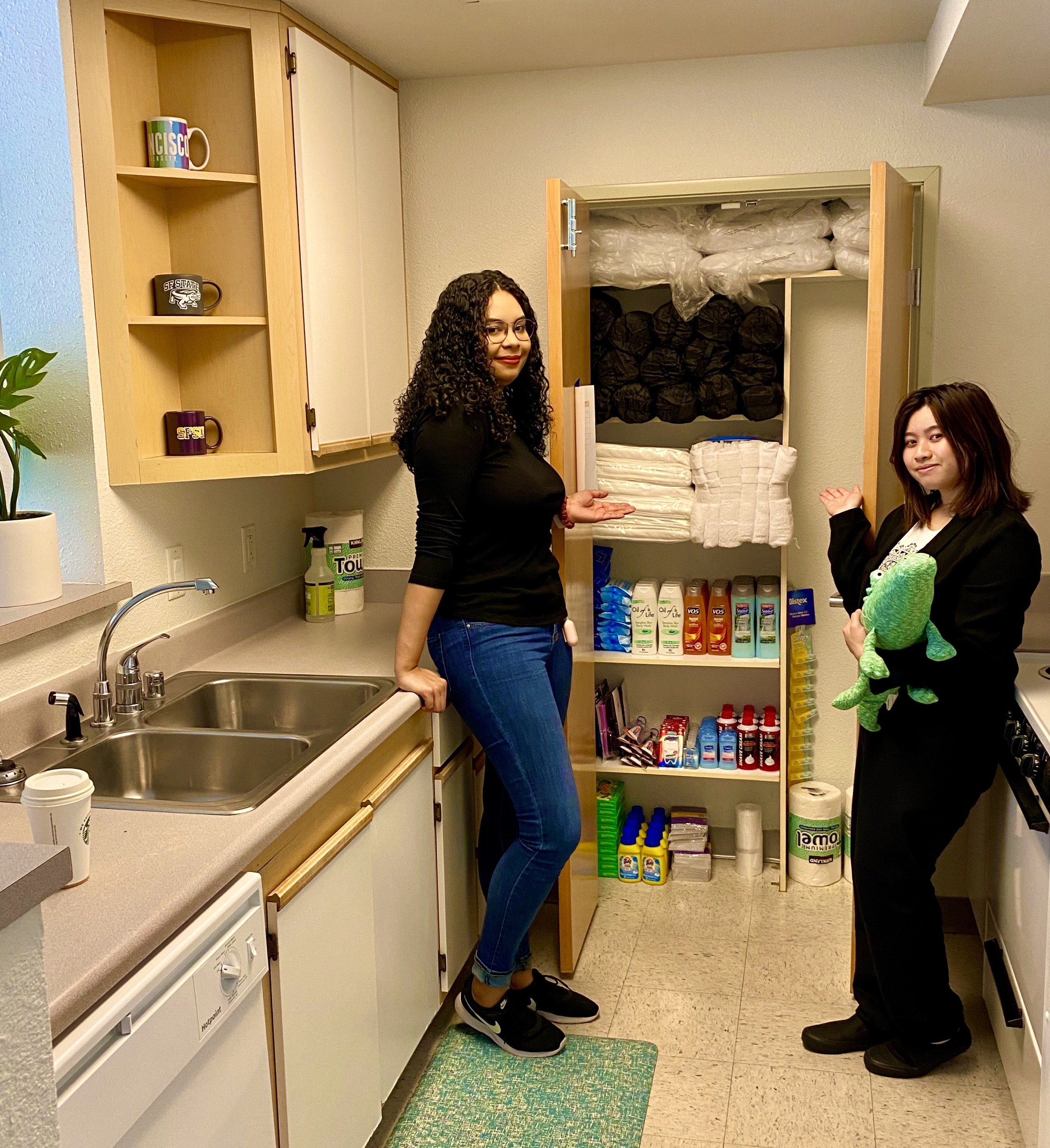 Two students standing in a Gator Crisis Housing unit